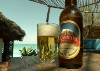 Kilimanjaro Beer on the Beach Zanzibar Tanzania | The Girl Next Door is Black