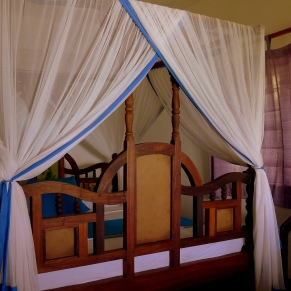 My room. The mosquito net is decorative and functional.