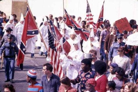 KKK leader and members marching past protesters during a downtown rally in Tallahassee, Florida, 1977.  Photo cr: WTSP archive